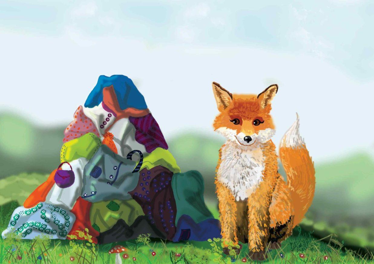 Lis przy stercie ciuchów